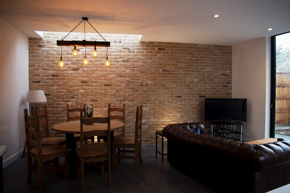 Exposed brick wall in a kitchen extension