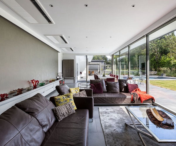 A glazed extension with a wall of sliding glass doors