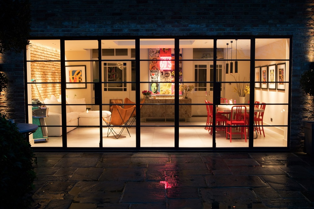 Night view of an industrial style home extension in London