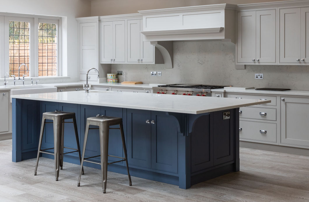 Blue and grey shaker kitchen units in a kitchen extension