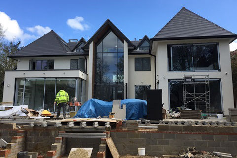 Fitting floor-to-ceiling glazing to the exterior of a new build house