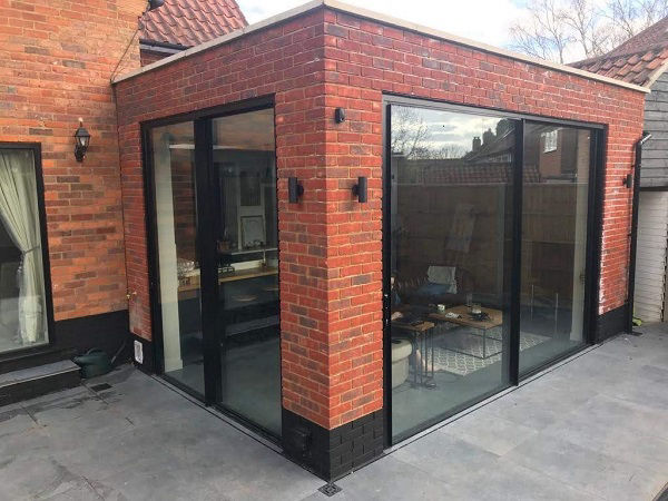 house extension with red multi stock brick wall in Hertfordshire
