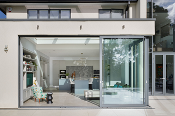 Sliding glass doors connecting a house extension with the garden