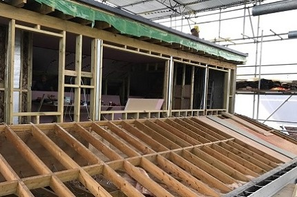 Building trusses to support a flat roof dormer
