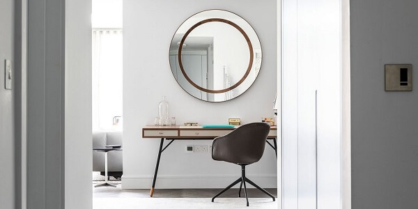 Round wall mirror in a new build house